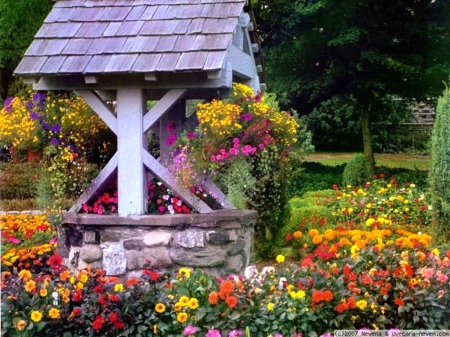 Wishing Well with flowers-1077036-bigthumbnail