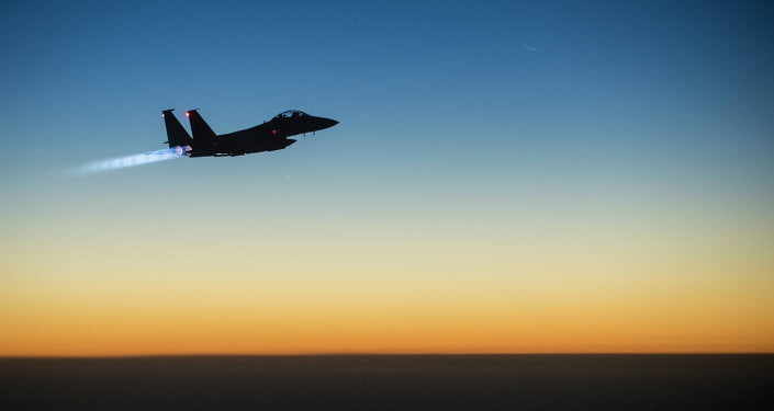 A US Air Force F-15E Strike Eagle aircraft flies over northern Iraq Sept. 23, 2014