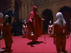 A scene from the movie Eyes Wide Shut of Stanley Kubrick, depicting a Satanic-sexual black magic ritual at an elite mansion.