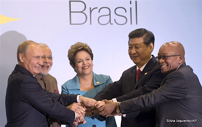 Leaders of the BRICS nations, from left, Russia's President Vladimir Putin, India's Prime Minister Narendra Modi, Brazil's President Dilma Rousseff, China's President Xi Jinping and South Africa's President Jacob Zuma, pose for a group photo during the BRICS summit in Fortaleza, Brazil, Tuesday, July 15, 2014. The leaders of the BRICS nations are expected to officially create a bailout and development fund worth $100 billion. It's meant to be an alternative to the World Bank and the International Monetary Fund, which are seen as being dominated by the U.S. and Europe.