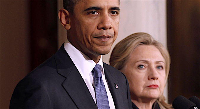 U.S. President Barack Obama pauses while speaking about Libya next to U.S. Secretary of State Hillary Clinton in the White House in Washington February 23, 2011. REUTERS/Kevin Lamarque (UNITED STATES - Tags: POLITICS)