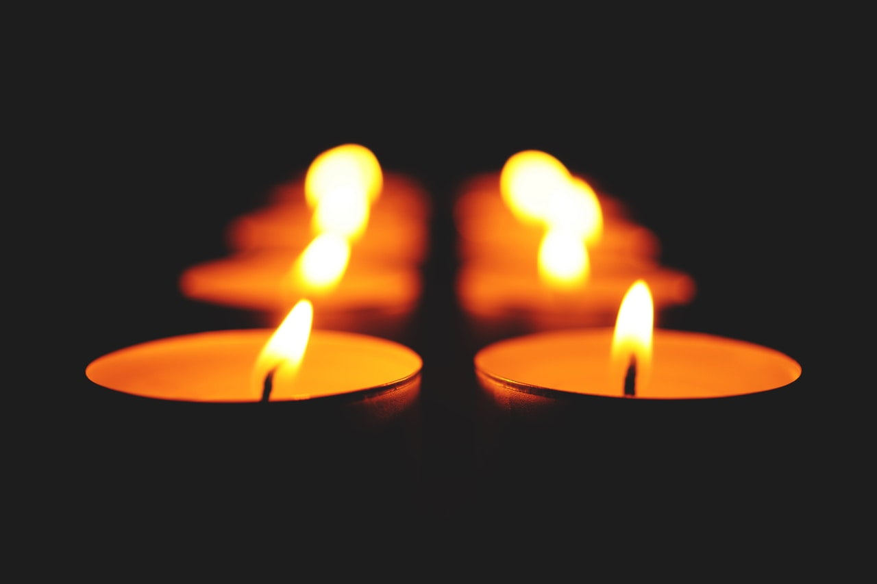 lit candles in rows