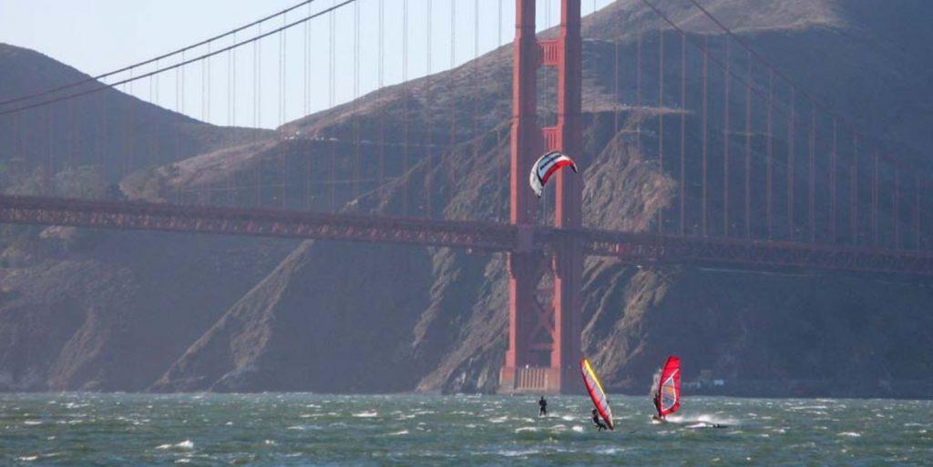 image: windsurfers under Golden Gate Bridge