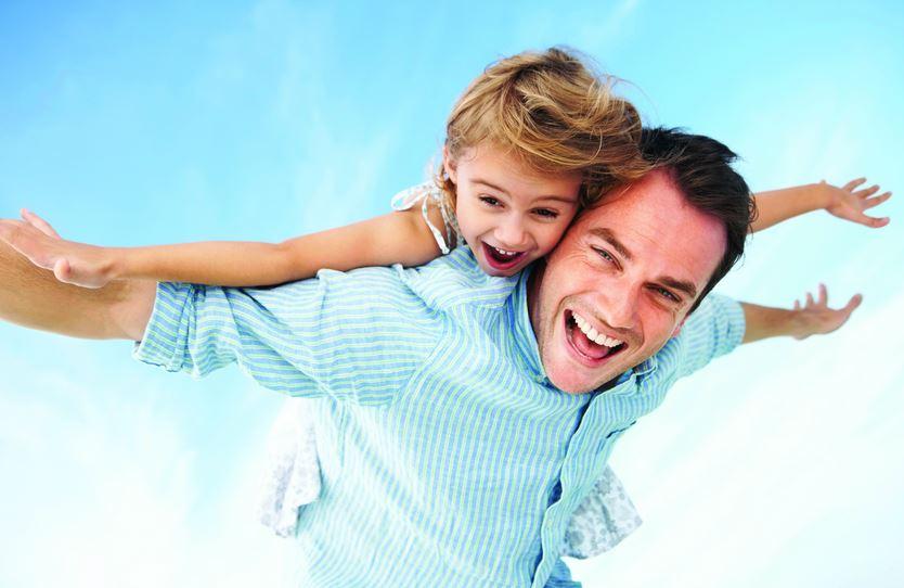 photo: man with daughter on piggyback