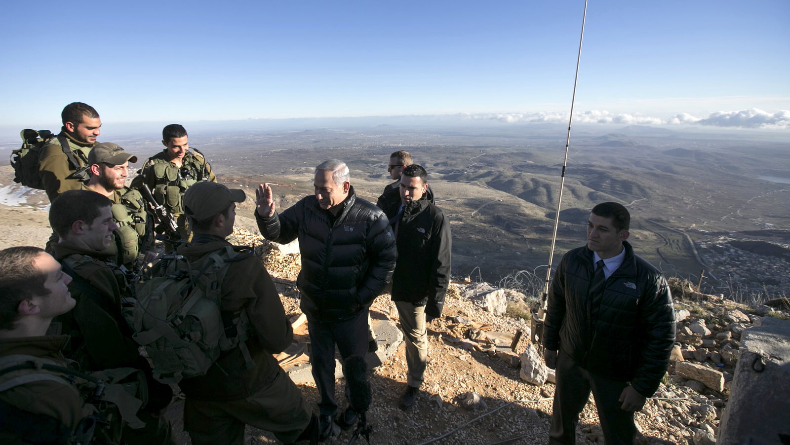 Israel's Prime Minister Benjamin Netanyahu, center, talks with Israeli soldiers at a military outpost during a visit at Mount Hermon in the Israeli-occupied Golan Heights overlooking the Israel-Syria border on, Feb. 4, 2015. Baz Ratner | AP