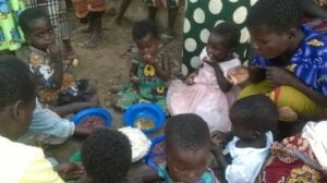 Children eating food at Nova Gaia orphanage