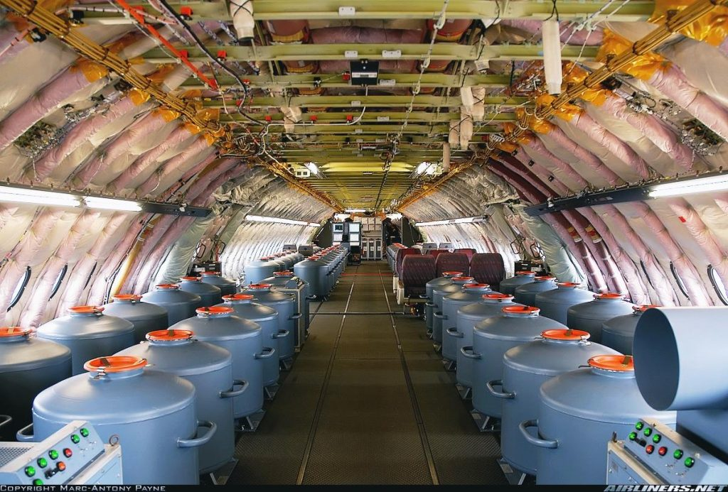 Many vats of something inside a very large plane