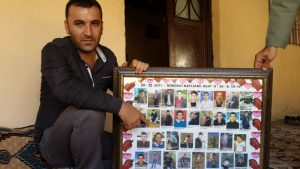 Sirnak MP Ferhat Encu points to his brother, Serhat, who was killed in the Roboski massacre